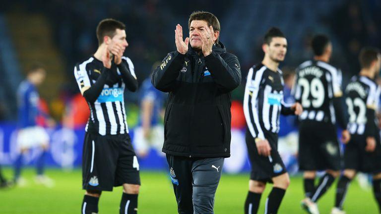 Newcastle caretaker boss John Carver applauds the travelling fans