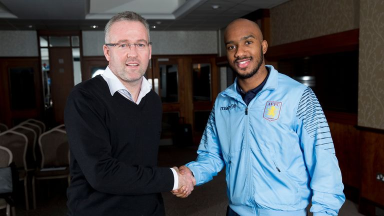 Fabian Delph of Aston Villa poses for a picture with Paul Lambert manager