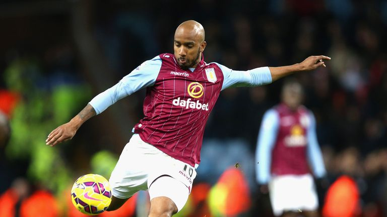 BIRMINGHAM, ENGLAND - JANUARY 17:  Fabian Delph of Aston Villa on th ball during the Barclays Premier League match between Aston Villa and Liverpool at Vil