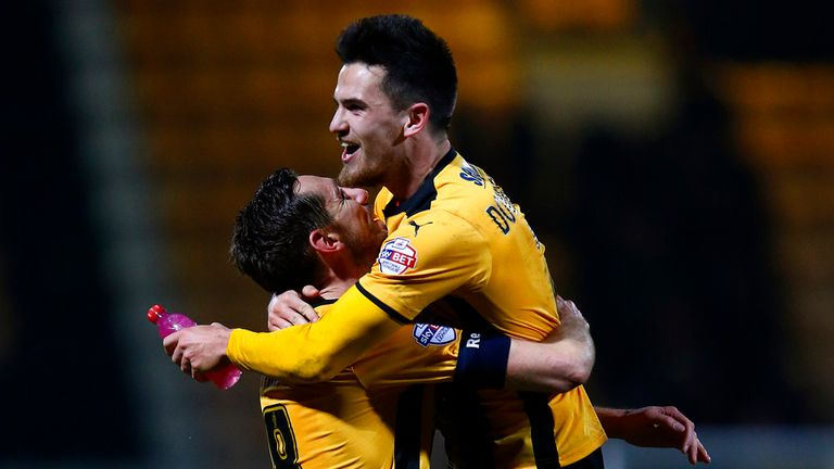 Ryan Donaldson of Cambridge United celebrates with team-mate Tom Champion after the FA Cup Fourth Round match