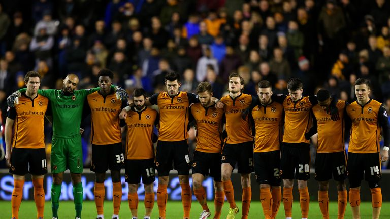 Wolves players observe a minute's silence for former owner Sir Jack Hayward.