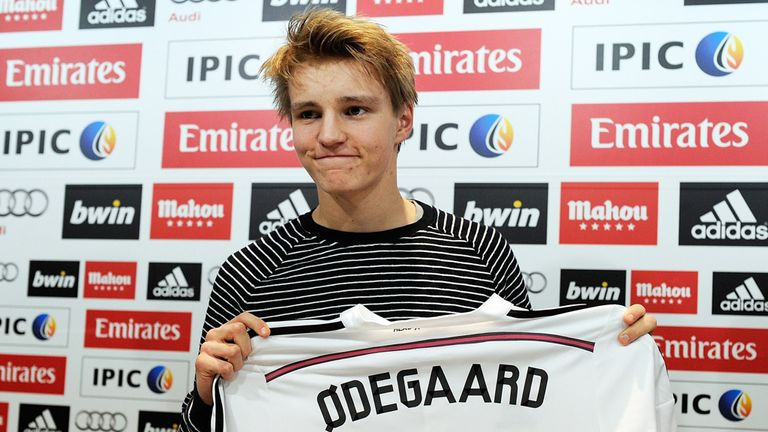 Martin Odegaard with his Real Madrid shirt