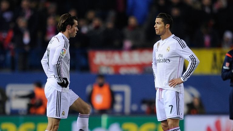 MADRID, SPAIN - JANUARY 07:  Cristiano Ronaldo and Gareth Bale of Real Madrid get ready to kick off the ball after Club Atletico de Madrid
