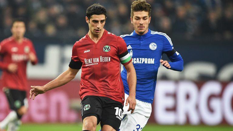 GELSENKIRCHEN, GERMANY - JANUARY 31:   Roman Neustadt of Schalke  challenges Lars Stindl of Hannover