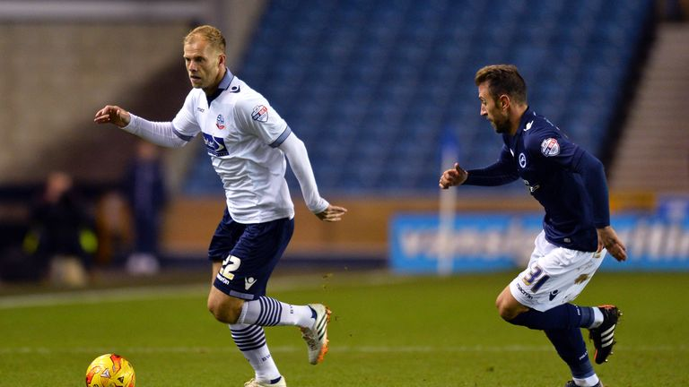 Eidur Gudjohnsen of Bolton and Angel of Millwall FC in action during the Sky Bet Championship match between Millwall and Bolton Wanderers at The Den.