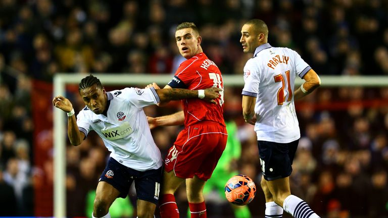 Jordan Henderson battles for the ball with Neil Danns and Darren Pratley