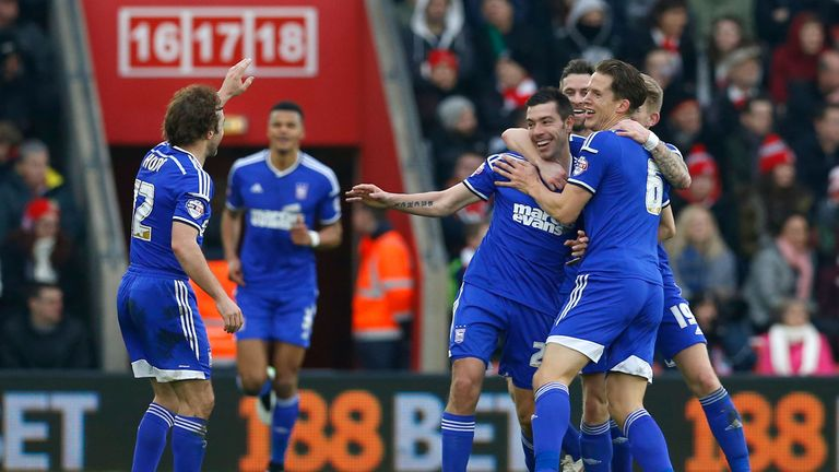 Darren Ambrose: Celebrates with his team-mates after scoring the opener for Ipswich