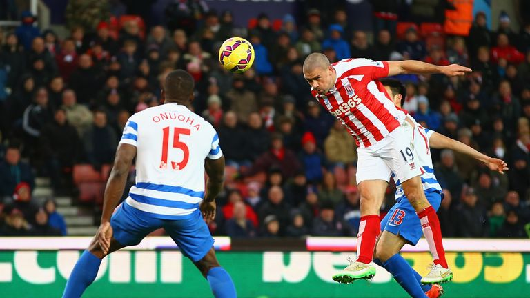Jonathan Walters heads in Stoke City's third goal for a hattrick during the match against Queens Park Ranger