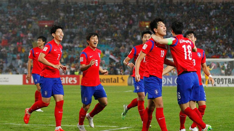 SYDNEY, AUSTRALIA - JANUARY 26:  Kim Young Gwon of Korea Republic celebrates with team mates after scoring a goal during the Asian Cup Semi Final match bet