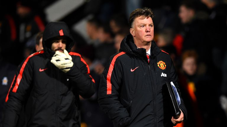 Louis van Gaal walks off the pitch after the FA Cup Fourth Round match between Cambridge United and Manchester United