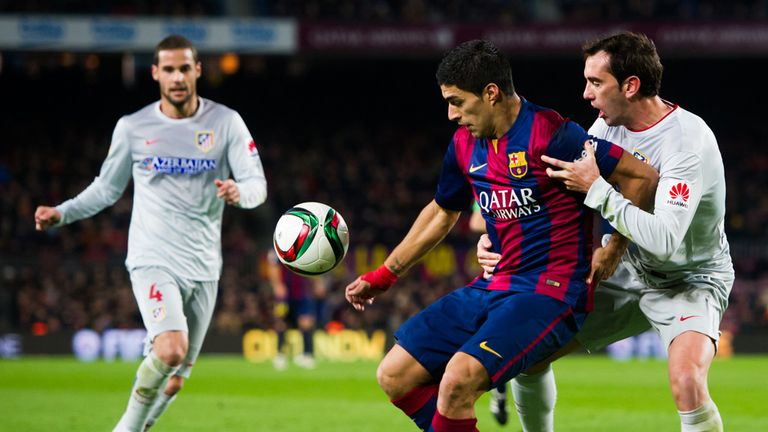 Luis Suarez fights for the ball with Diego Godin