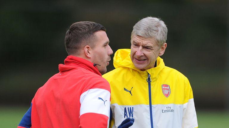 Lukas Podolski and Arsene Wenger, Arsenal training, December 2014