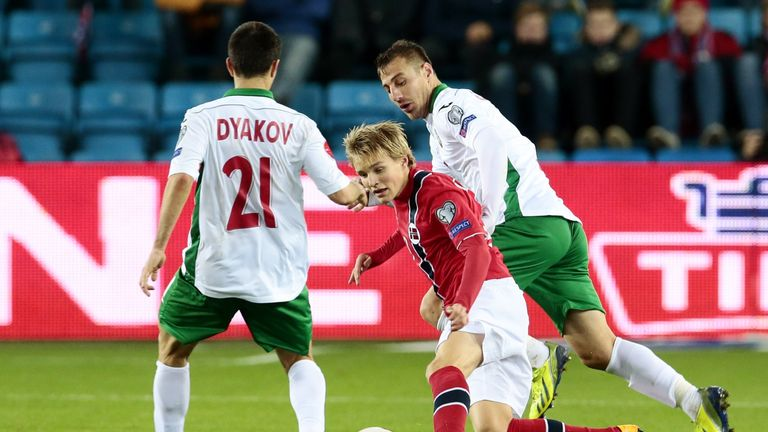 Norway's youngest player ever, Martin Odegaard (C) vies during the Euro 2016 Group H qualifying football match Norway vs Bulgaria in Oslo, Norway