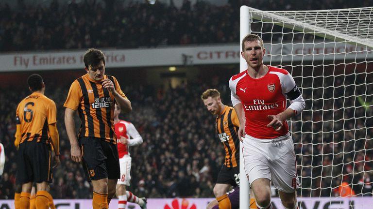 Arsenal defender Per Mertesacker celebrates