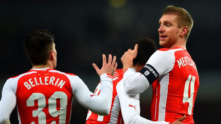 Per Mertesacker of Arsenal celebrates with team-mates after scoring the opening goal during the FA Cup Third Round match v Hull City
