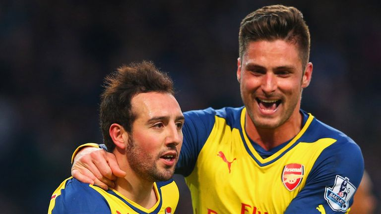 Santi Cazorla of Arsenal (L) celebrates with Olivier Giroud as he scores their first goal from a penalty