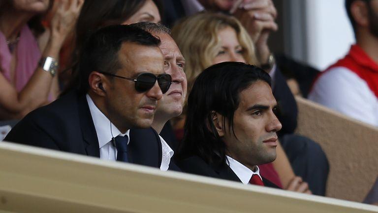 Monaco's Colombian forward Radamel Falcao (R) and his agent Jorge Mendes (L)