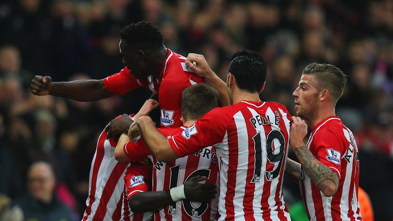 SOUTHAMPTON, ENGLAND - JANUARY 01:  Sadio Mane of Southampton (obscured) celebrates with team mates as he scores their first goal during the Barclays Premi