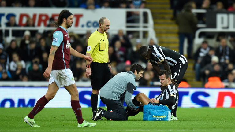 Newcastle United player Steven Taylor is treated for an injury against Burnley
