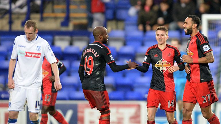 Tom Carroll celebrates scoring his team's second goal