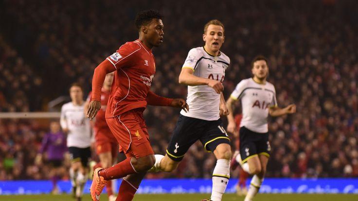 Tottenham Hotspur's Harry Kane (R) runs across to tackle Liverpool's Daniel Sturridge