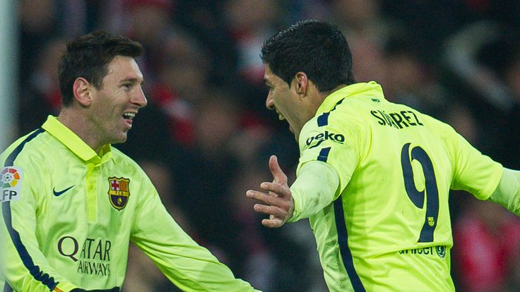Luis Suarez celebrates with Lionel Messi after scoring his goal in a La Liga match against Athletic Bilbao