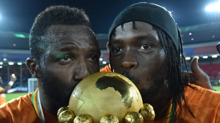 Ivory Coast's forward Gervinho kisses the trophy at the end of the 2015 African Cup of Nations final football match between Ivory Coast and Ghana in Bata