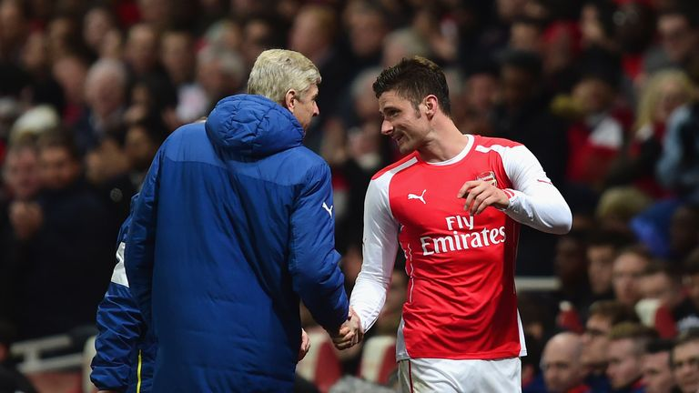 Arsene Wenger, manager of Arsenal shakes hands with Olivier Giroud of Arsenal during the FA Cup fifth round match v Middlesbrough