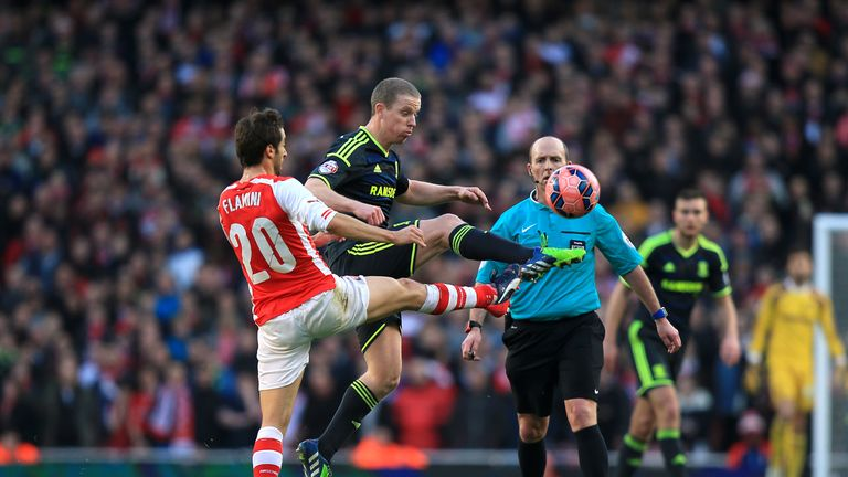 Arsenal's Mathieu Flamini and Middlesbrough's Grant Leadbitter (centre) battle for the ball during the FA Cup Fifth Round match at the Emirates Stadium