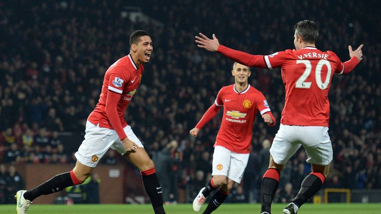 Manchester United's Chris Smalling (L) celebrates with  Robin van Persie and Adnan Januzaj (C)