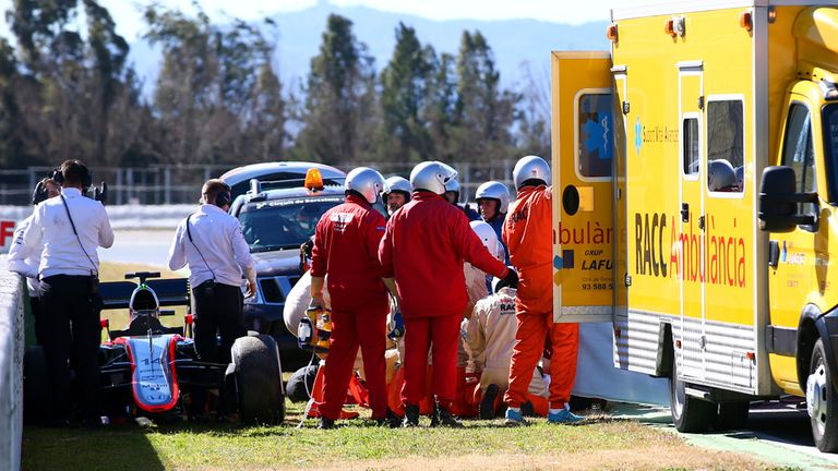Fernando Alonso receives medical assistance after his accident