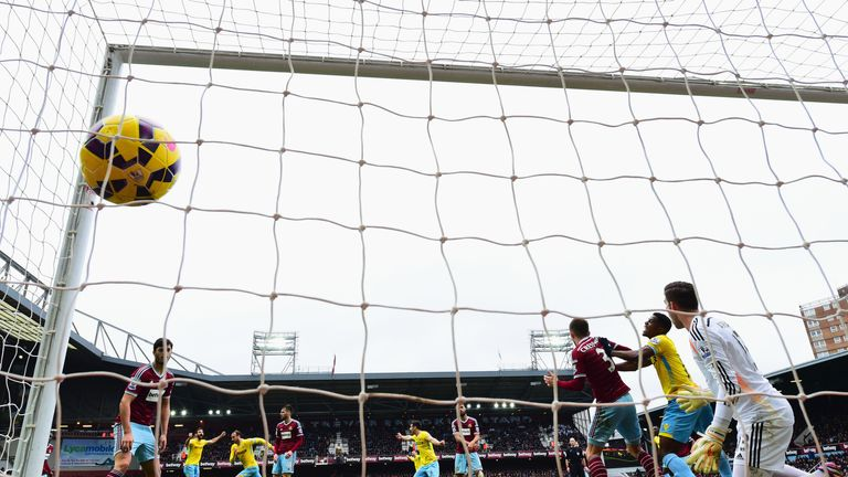 Glenn Murray of Crystal Palace scores their first goal with a header against West Ham
