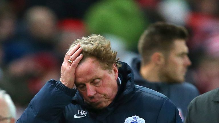 QPR manager Harry Redknapp leaves the field after defeat during the Barclays Premier League match at Stoke