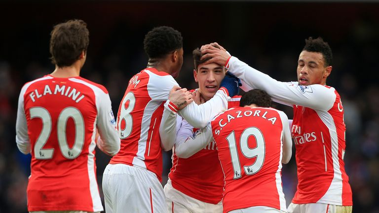 Arsenal's Hector Bellerin (centre) celebrates scoring his side's fifth goal during the Barclays Premier League match v Aston Villa, London