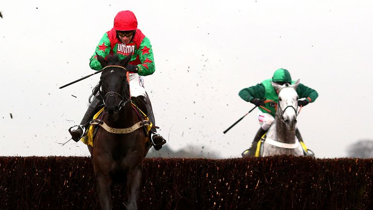 Wayne Hutchinson and Balder Succes take the final fence from Ma Filleule and Barry Geraghty on their way to success in the Betfair Ascot Chase.