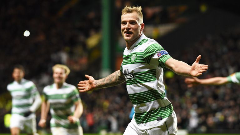 Celtic's John Guidetti celebrates after scoring his side's third goal
