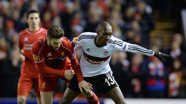 Liverpool midfielder Adam Lallana vies for the ball with Atiba Hutchinson