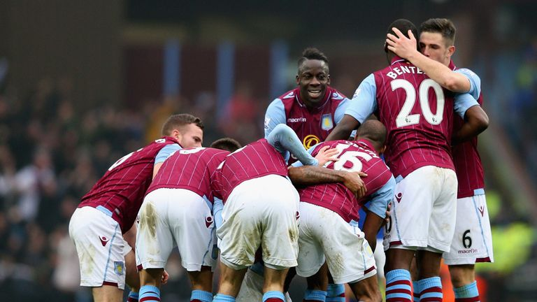 Leandro Bacuna of Aston Villa is mobbed by team mates