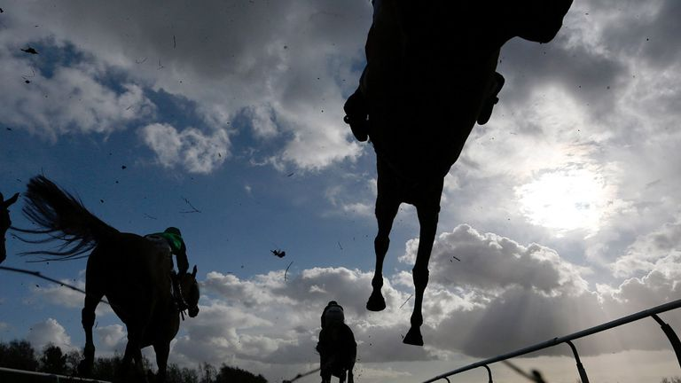 A general view as runners clear the water jump in the Squire Osbaldeston Handicap Chase at Leicester