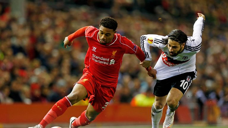 LIVERPOOL, ENGLAND - FEBRUARY 19:  Jordon Ibe of Liverpool goes past Olcay Sahan of Besiktas during the UEFA Europa League Round of 32 match between Liverp