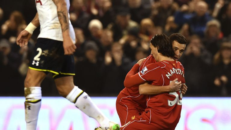 Liverpool's Lazar Markovic celebrates after scoring the opening goal against Tottenham