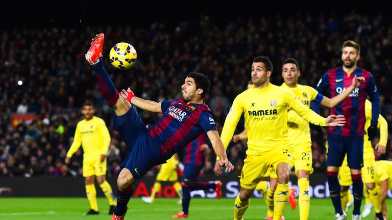 Luis Suarez of FC Barcelona performs an overhead during the La Liga match between FC Barcelona and Villarreal CF at Camp Nou