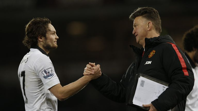 Louis van Gaal (R) shakes hands with goal-scorer Manchester United's Dutch midfielder Daley Blind
