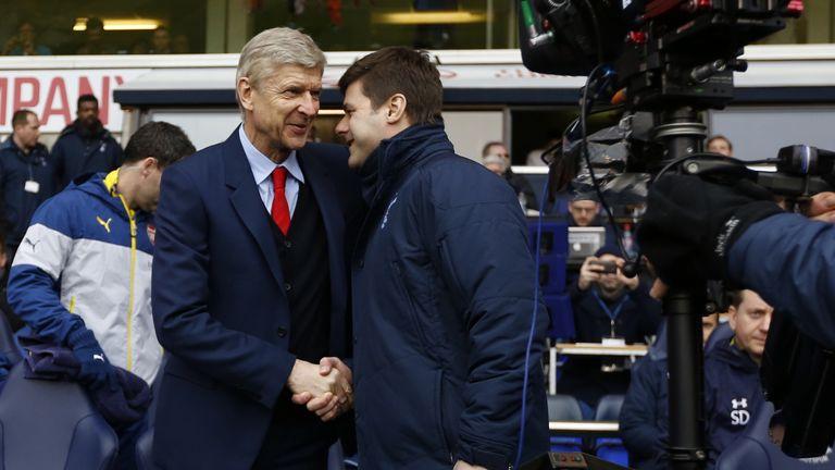 Arsenal manager Arsene Wenger shakes hands with Tottenham's head coach Mauricio Pochettino