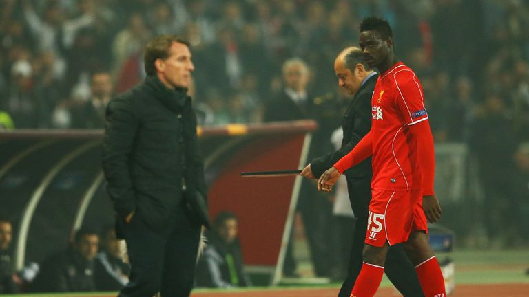 Mario Balotelli looks across as Brendan Rodgers