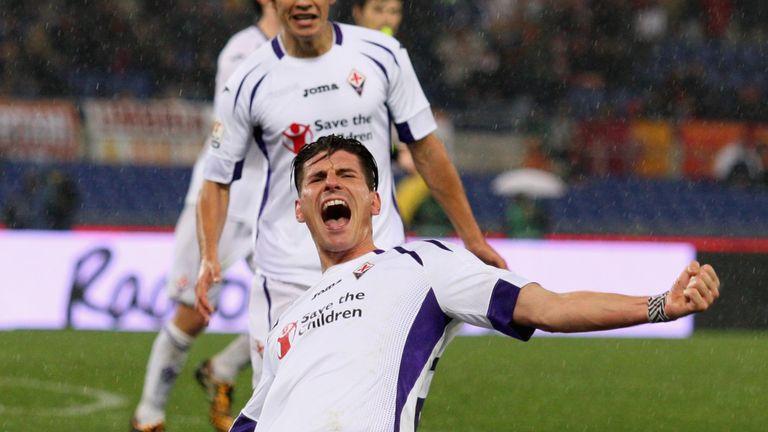 Mario Gomez celebrates scoring his second goal against Roma