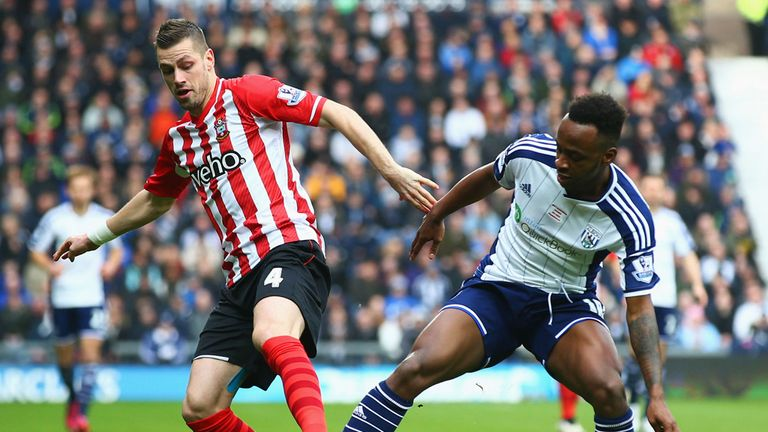 Saido Berahino is tackled by Morgan Schneiderlin