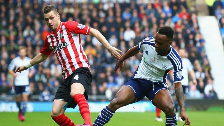 Saido Berahino of West Bromwich Albion and Morgan Schneiderlin of Southampton battle for the ball.
