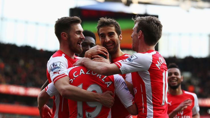 Mathieu Flamini of Arsenal celebrates scoring his team's third goal against West Ham