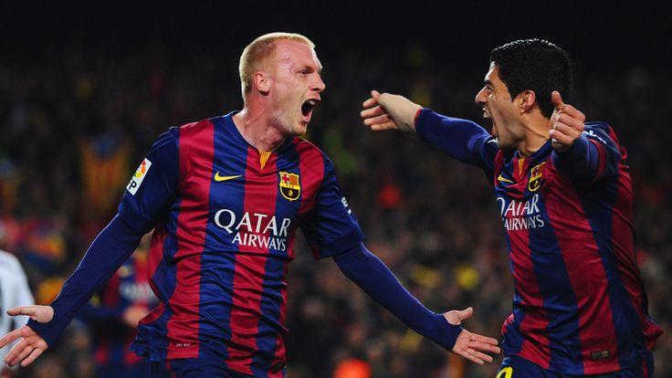 Jeremy Mathieu celebrates with Luis Suarez
